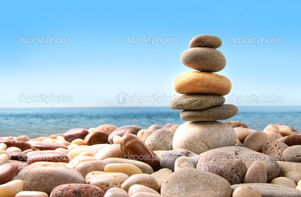Stack of pebble stones on white