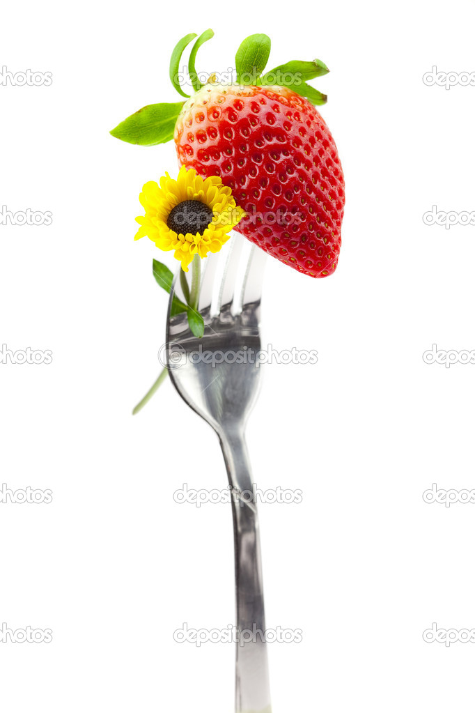 Strawberry and flower on a fork