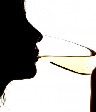 Silhouette of girl sparkling wine