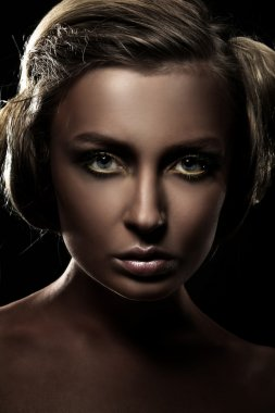 Dark portrait of a beautiful girl, studio shot