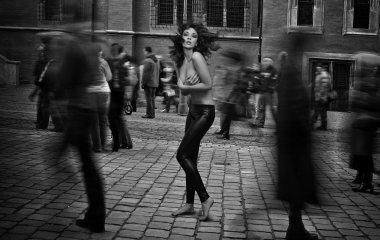 Fine art photo - topless brunette startled in the street crowd