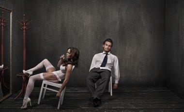 Attractive couple in a dark room