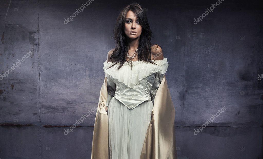 hermoso vestido de mujer joven — Foto de stock © konradbak #4489681