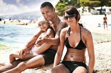 Happy family on a ocean coast