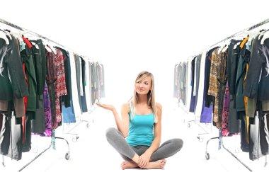 Calm blonde beauty in a wardrobe