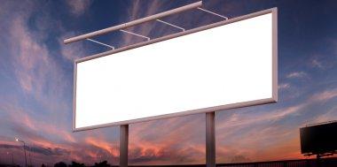 Blank big billboard over sunset sky