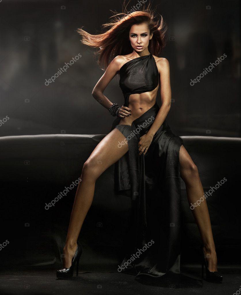 Beautiful brunette over dark background