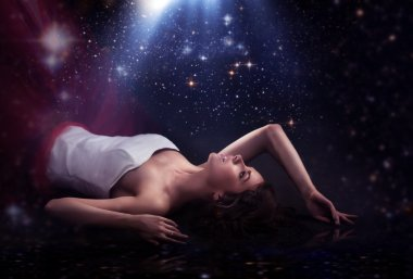 Sensual lady laying over romantic background