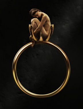 Beautiful young beauty in a golden ring
