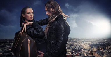 Young couple over the city background