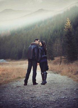 Romantic photo of a kissing couple