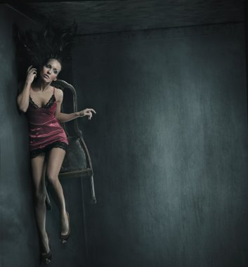 Fine art photo of a woman on the chair