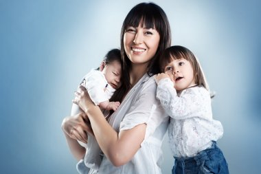 Loving mother holding son and daughter