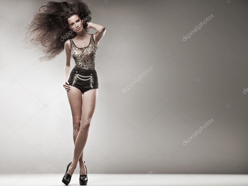 Fashion style photo of a young brunette
