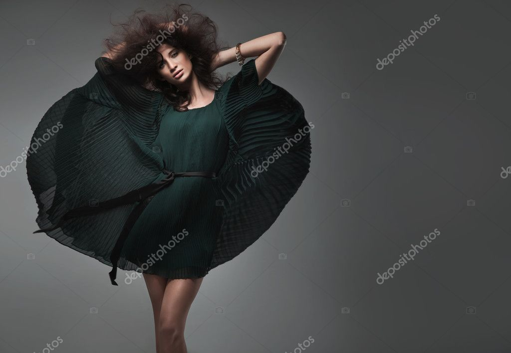 Vogue style studio shot of a young woman