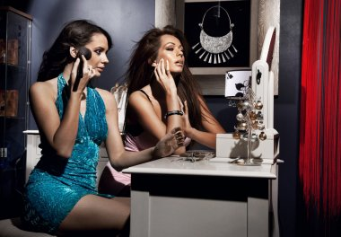 Two beautiful girls doing make up befor night party