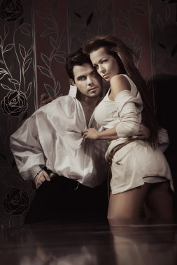 Young sexy couple in romantic pose