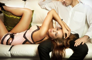Cute brunette in lingerine posing with a man