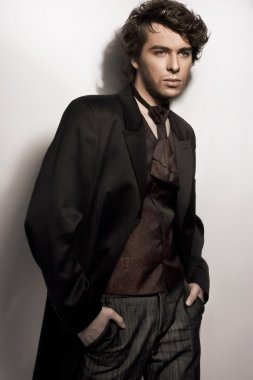 Amazing photo of young elegant man posing