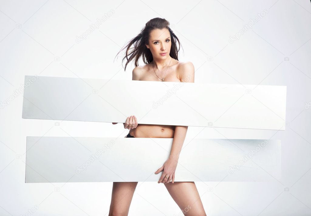 Portrait of a naked businesswoman holding the whiteboard