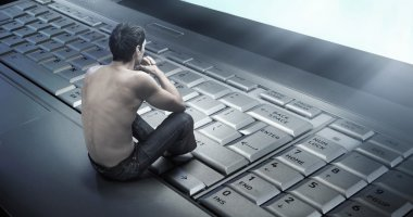 Conceptual photo of a young man addicted to the internet