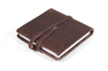 Leather bound notebook with closing strap