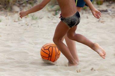 Boys playing beach soccer