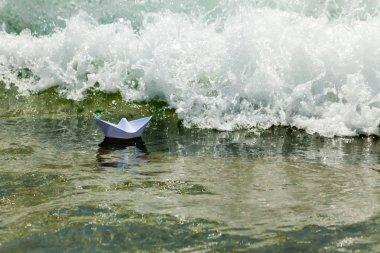 Paper boat now die in a huge wave