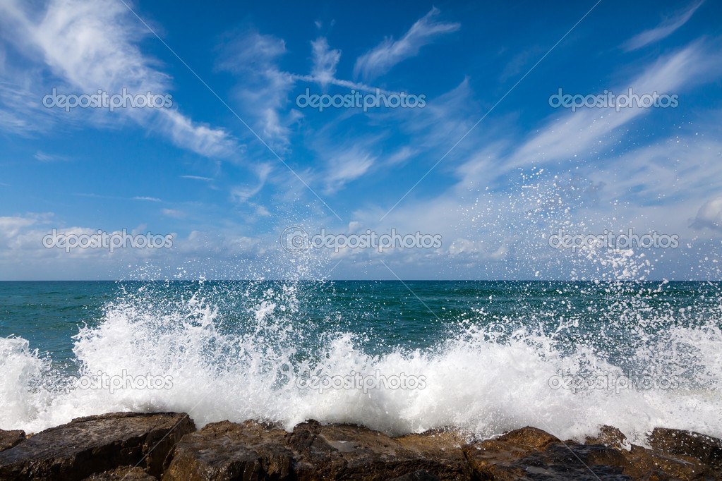 The waves breaking on a stony beach