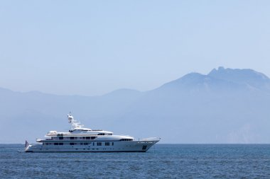 Cruising yacht in the sea on the background of mountains