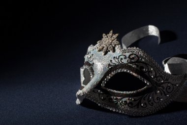 Black and silver mask