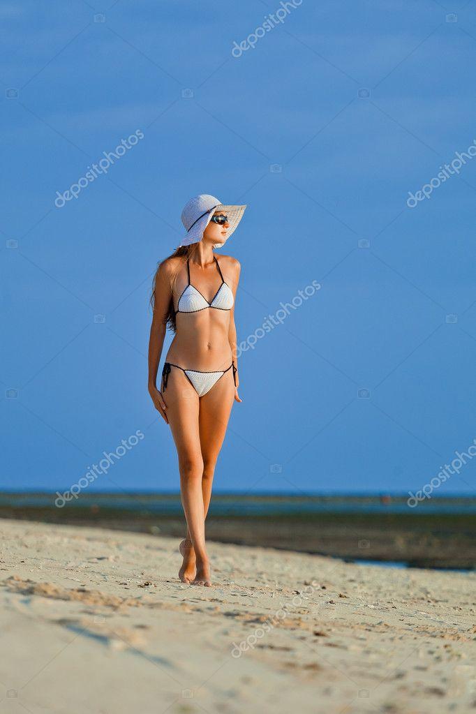 A beautiful woman wearing white bikini