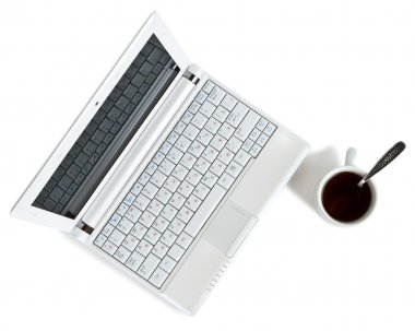 White netbook with coffee top view