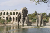 Aqueduct with water wheel in Hama, Syria