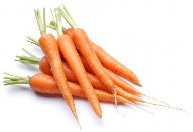 Ripe fresh carrots on a white background.