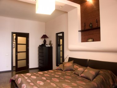 Bedroom with the big double bed with white bed. Design in East style