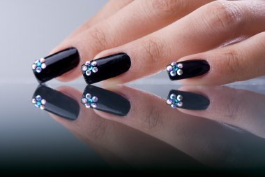 The refined beautiful female fingers with original design manicure