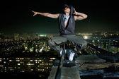 Fotografie extreme tanz am rande eines daches