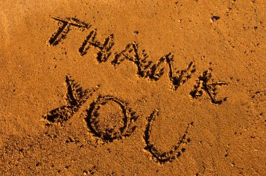 Thank you message on sand