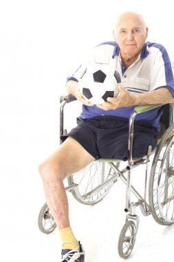 Shot of a disabled man in wheelchair with soccer ball