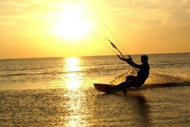 Kitesurfing and sunset