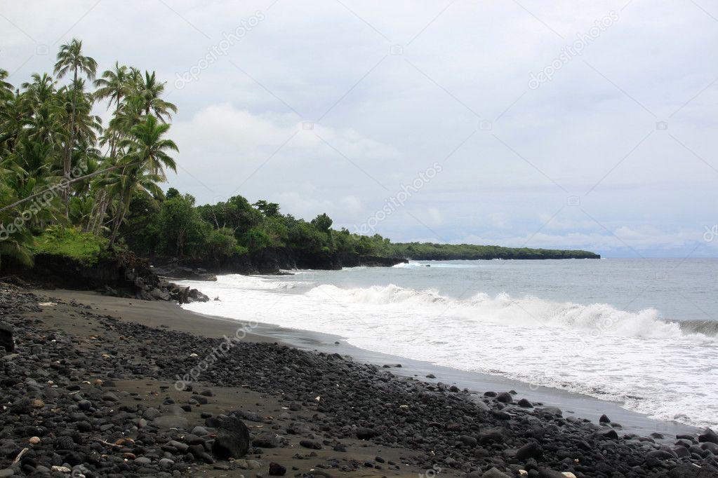 Black sand beach in Samoa
