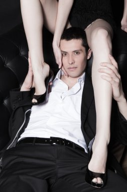 Portrait of attractive young man embracing womans perfect legs