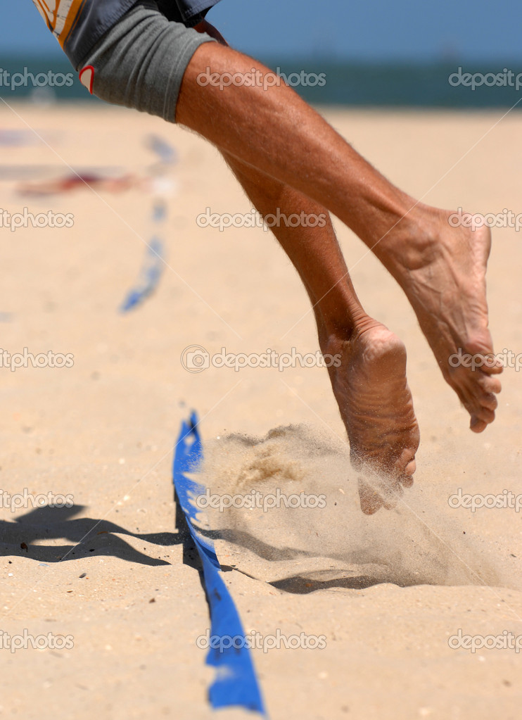 Legs of a male beach volleyball player