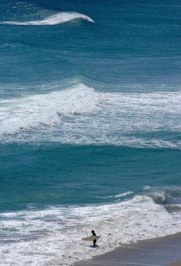 surfer in blue water