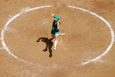Female softball player pitches ball