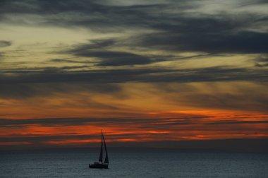 sailboat drifting on water
