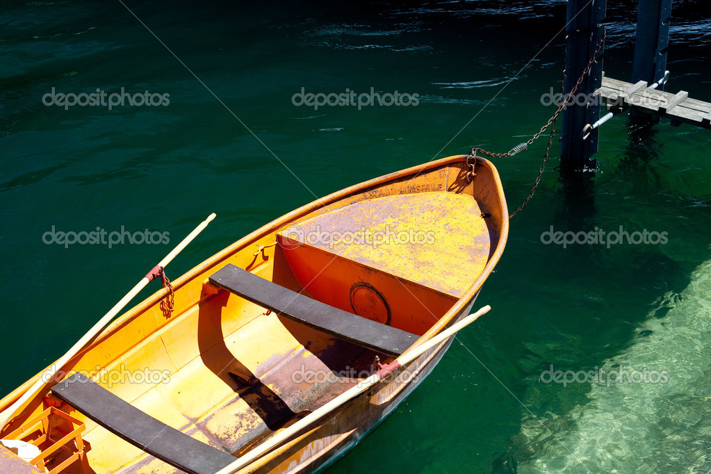 Orange boat on water