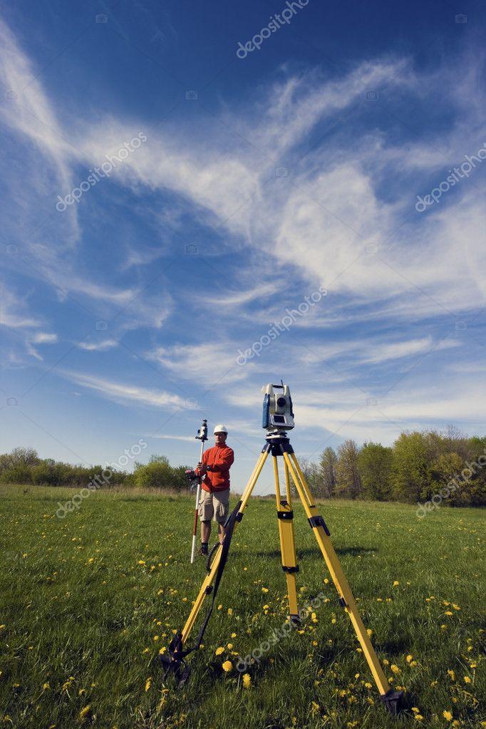 Land Surveyor working with robotic station
