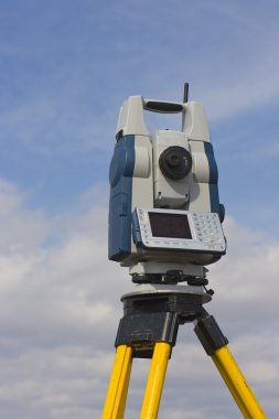 Theodolite against cloudy sky
